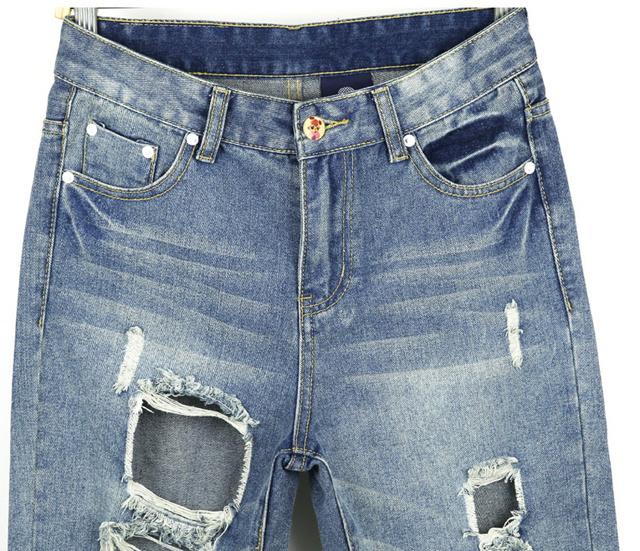 长裤 腰型:低腰 裤型:滑板裤 面料:牛仔布 厚薄:普通 细节:磨白,破洞